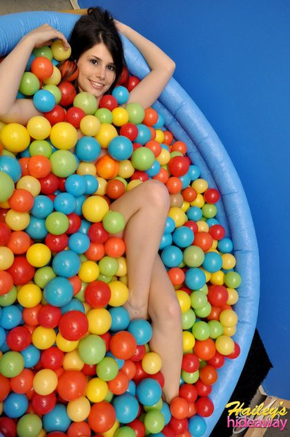 teen covered in balls